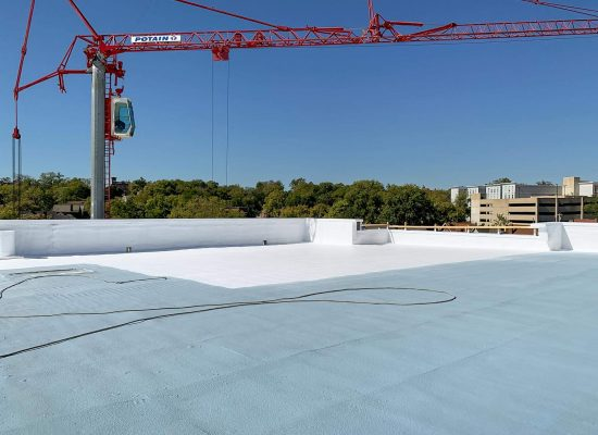 Apply white reflective top coat at approximately two gallons per square foot on the entire roof area.