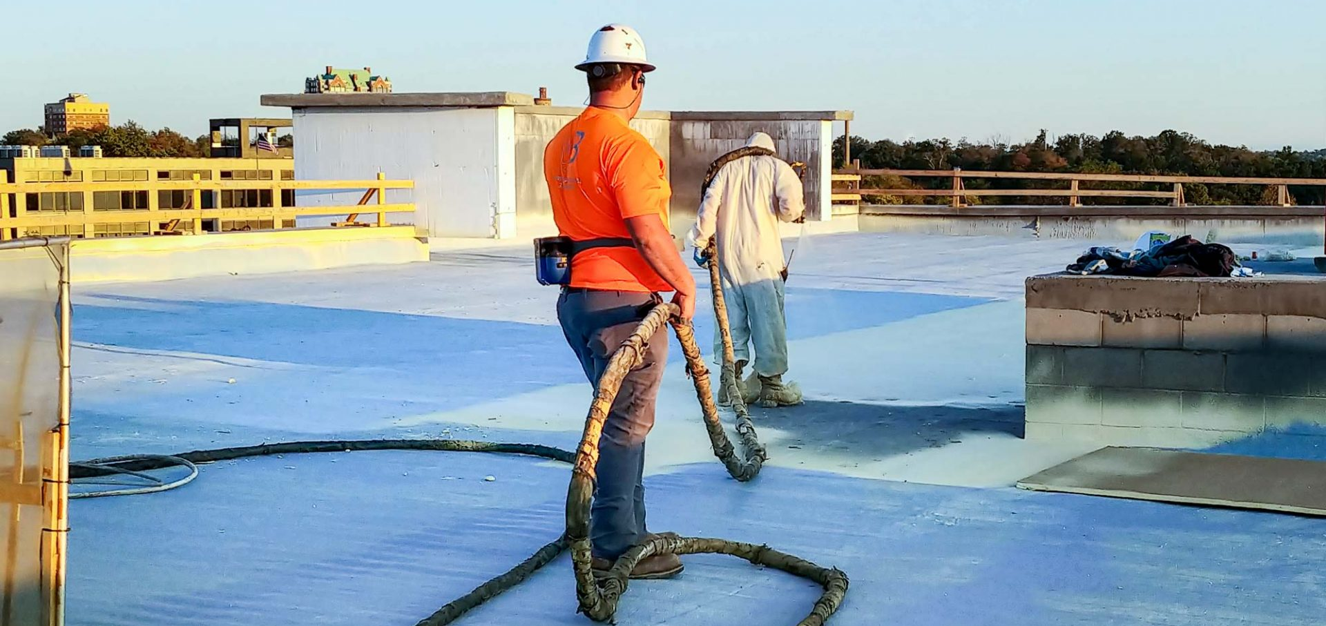 Applying SPF commercial roof coating